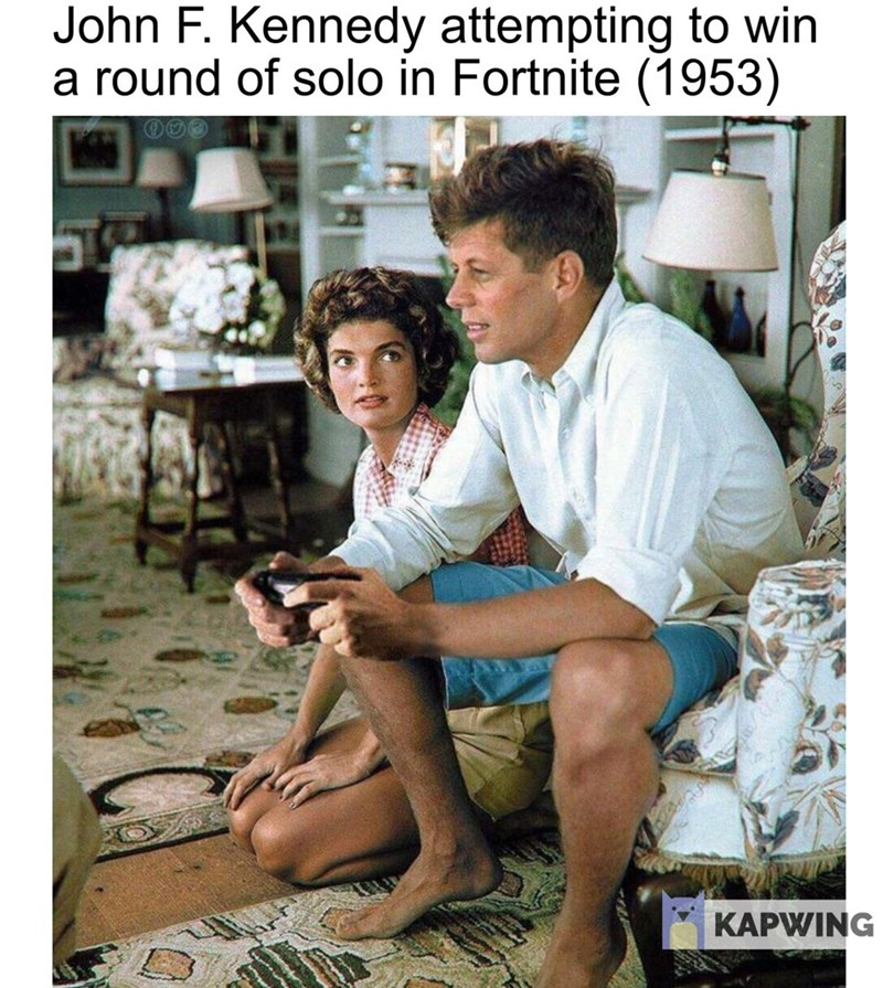 """Caption that reads, """"John F. Kennedy attempting to win a round of solo in Fortnite (1953)"""" above a pic of JFK appearing to be holding a video game controller"""