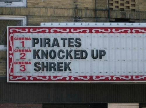 "cinema theater sign saying ""pirates knocked up Shrek"""