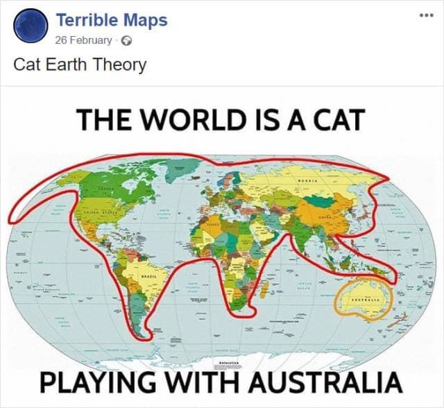 meme image of world map and it's shaped like a cat and cat is playing with Australia