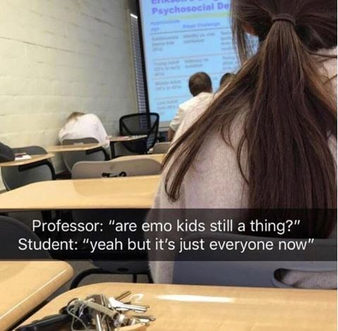 """Pic of a girl sitting in class with Snapchat text overlay that reads, """"Professor: Are emo kids still a thing? Student: Yeah but it's just everyone now"""""""