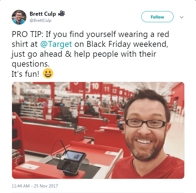 Tweet about wearing red in Target during Black Friday with picture of smiling man in red