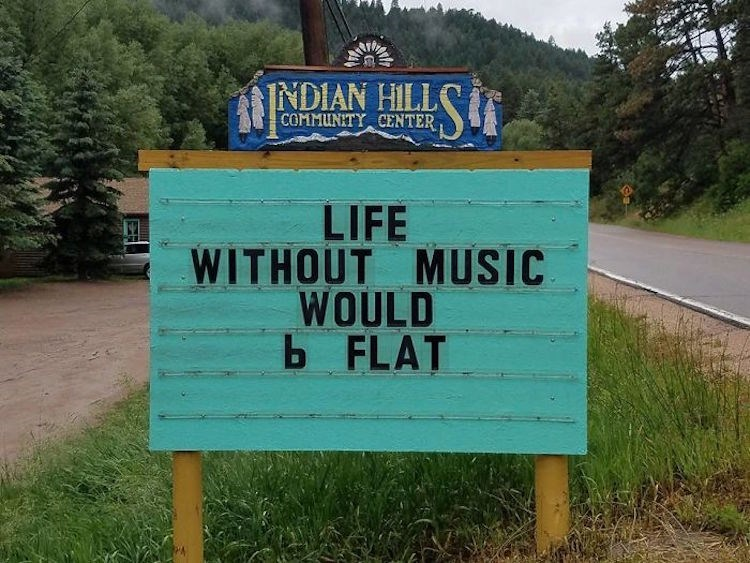 Indian Hills community center sign LIFE WITHOUT MUSIC WOULD b FLAT