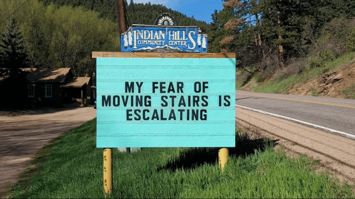 Indian Hills Community Center sign MY FEAR OF MOVING STAIRS IS ESCALATING