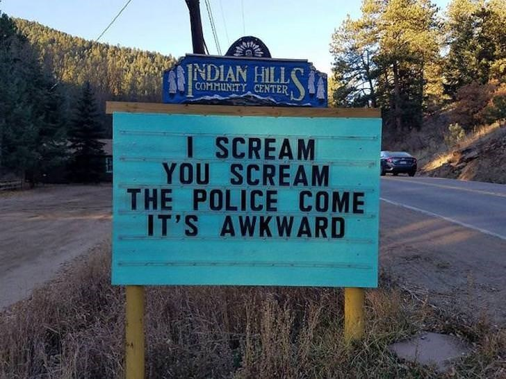 Street sign - INDIAN HILLS COMMUNITY CENTER I SCREAM YOU SCREAM THE POLICE COME IT'S AWKWARD