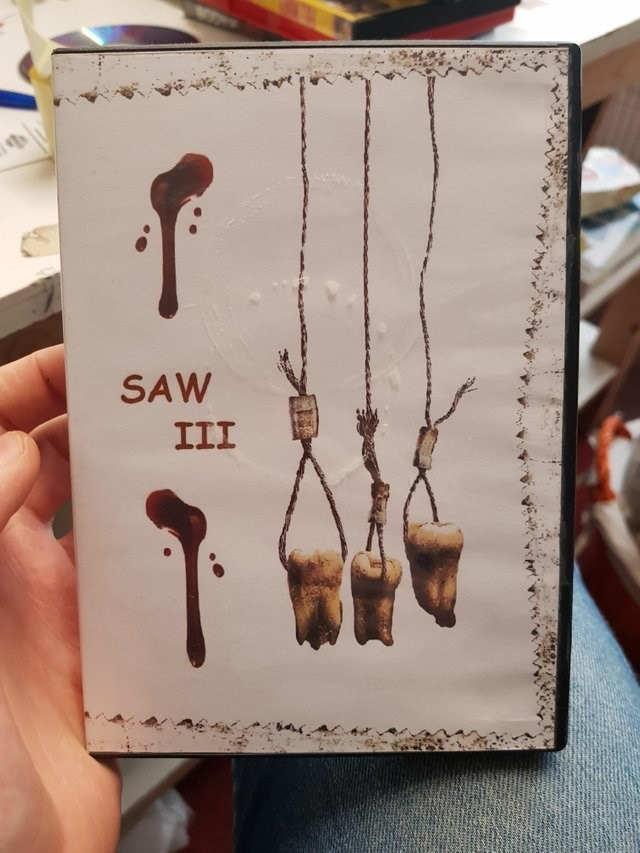 Saw III bootleg with cover title written in comic sans font