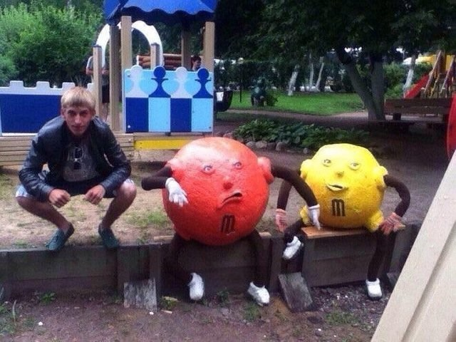 Russian Slavic M&M characters sitting menacingly on fence