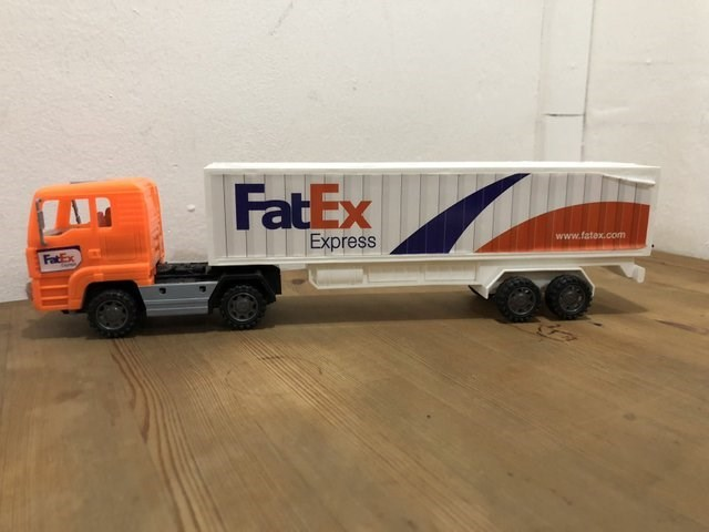 """toy truck with FedEx knockoff logo spelling """"FatEx"""""""
