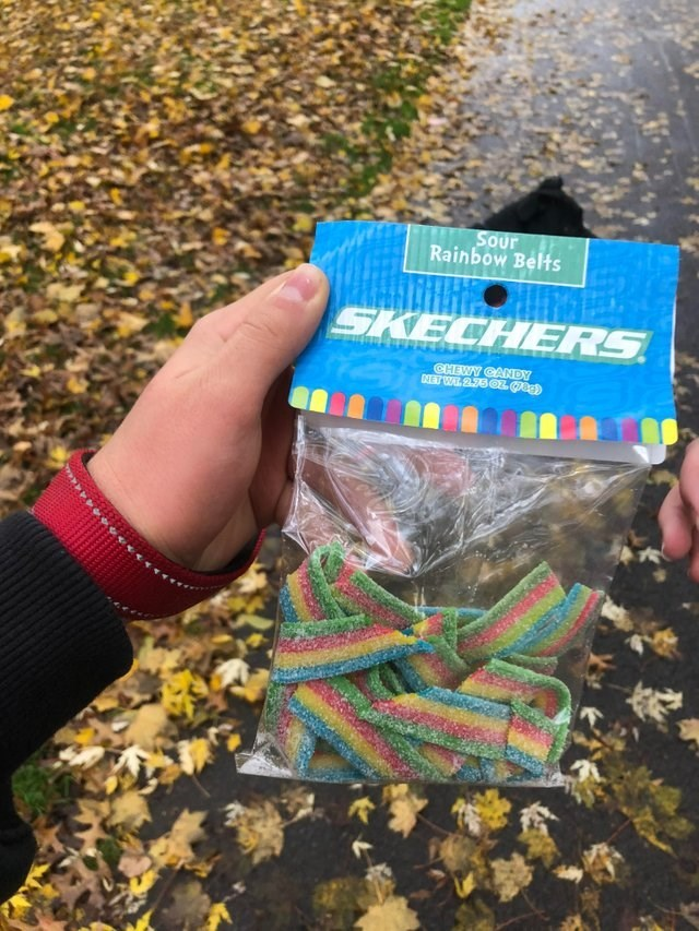 sour candy belts with the Sketchers sports brand logo
