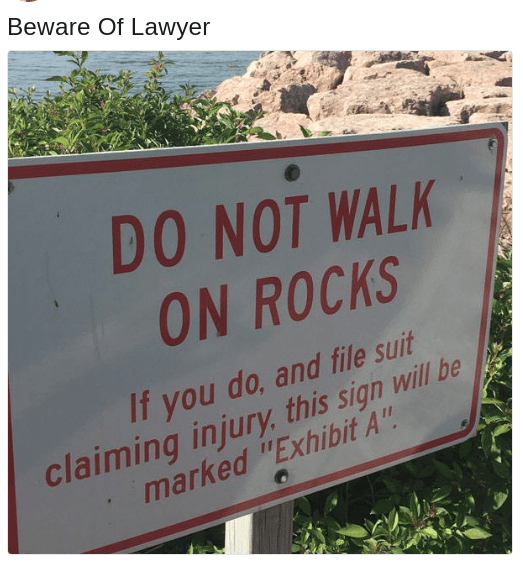 "Text - Beware Of Lawyer DO NOT WALK ON ROCKS If you do, and file suit claiming injury, this sign will be marked ""Exhibit A""."
