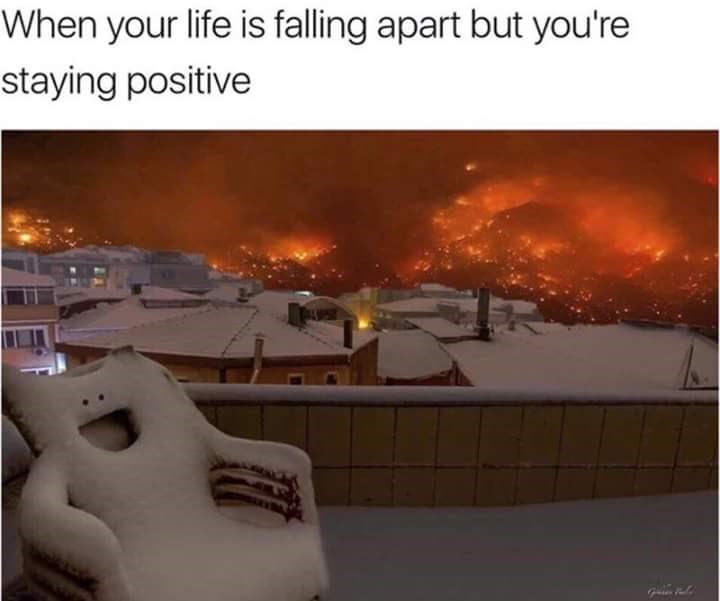 meme about staying positive while life is falling apart with picture of smiling chair in front of forest fire