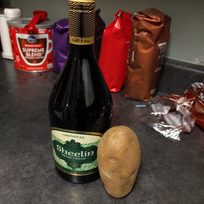Disney's Merida represented by potato next to bottle of Sheelin Irish cream