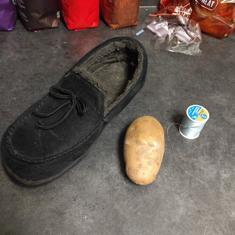 Disney's Cinderella represented by potato next to slipper shoe