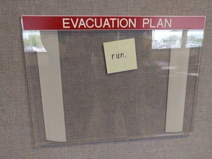 """picture of evacuation plan sign with the only instruction being a handwritten """"run"""" note"""
