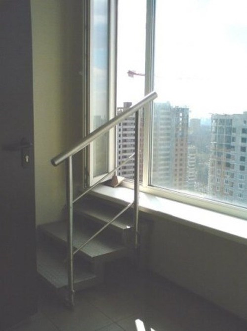 picture of stairway leading to an open window of a high floor
