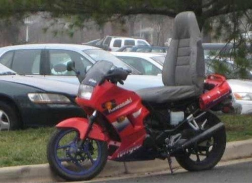 picture of motorcycle with car seat