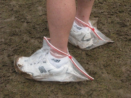 picture of person wearing Ziploc bags over white Nike shoes