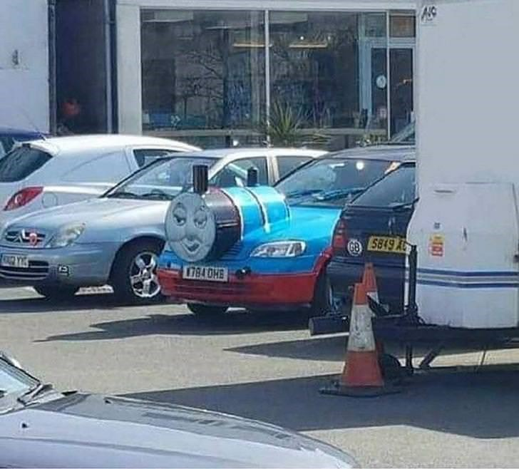 picture of car with Thomas the tank engine face installed on its hood