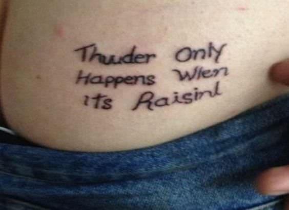 "misspelled tattoo reads ""thunder only happens when it's raisin"""