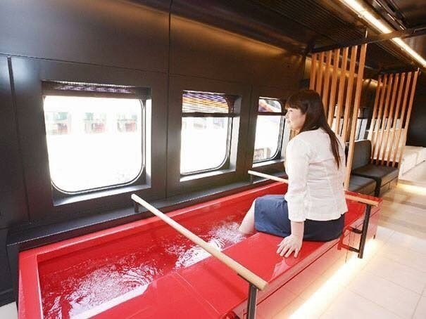 pic of woman dipping her feet inside water tank