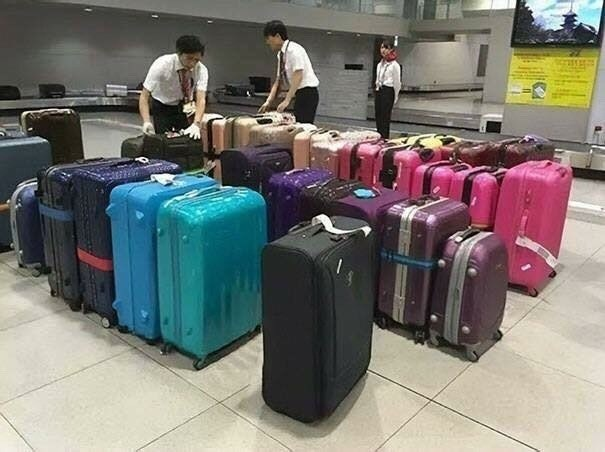 pic of airport workers in Japan arranging luggage by color