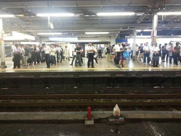 pic of people waiting in lines at a train station in Japan