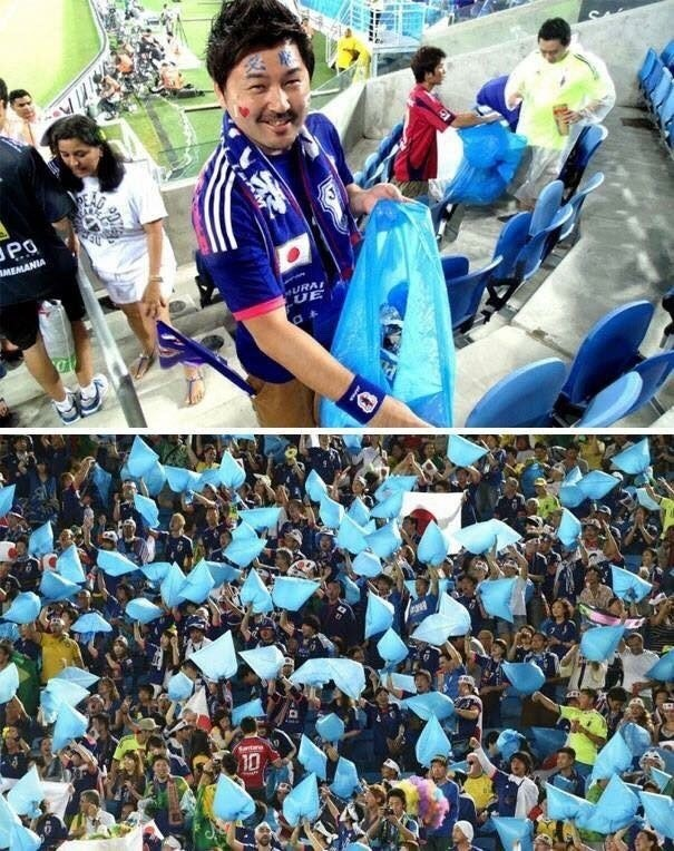 pic of Japanese football fans cleaning the stadium with blue bags