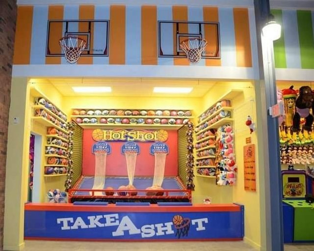 image of a basketball arcade and the name of it is 'take a shot' that looks like the word shit
