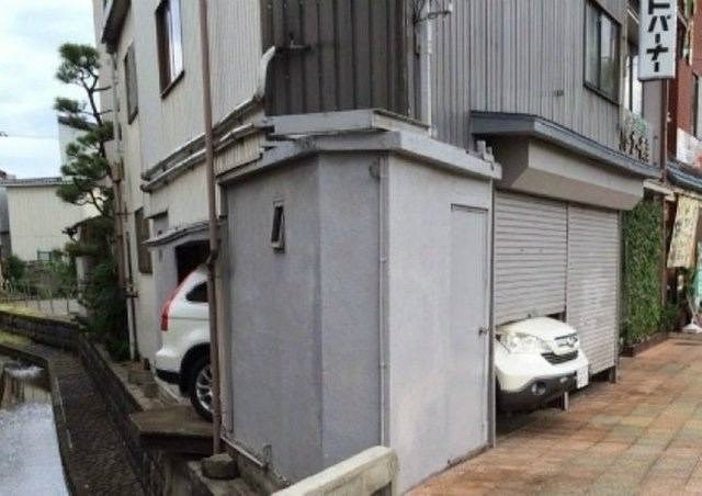 image of a car that is stuck under a garage door