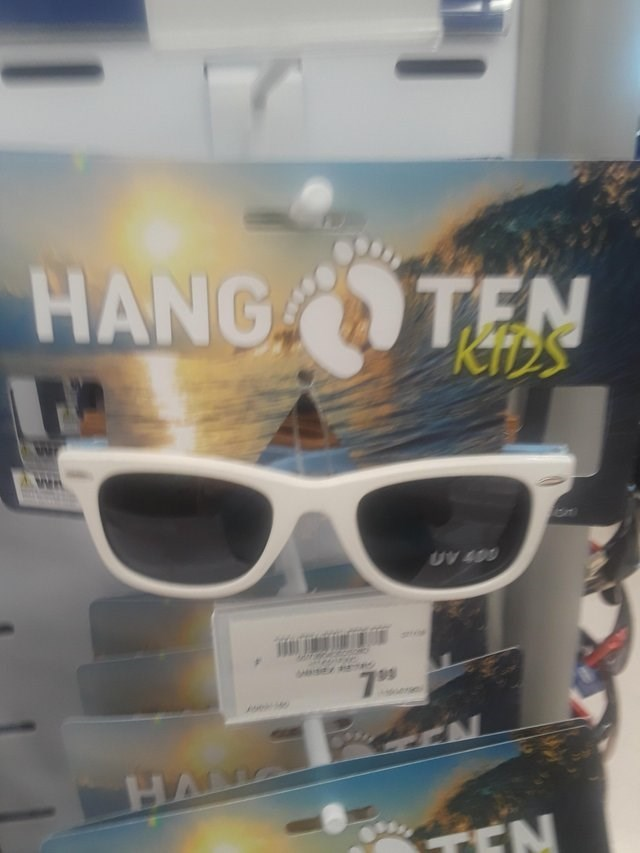 image of a sunglasses stand and the title is: 'hang ten kids'