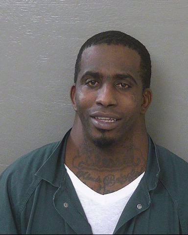 mugshot of man with massive neck