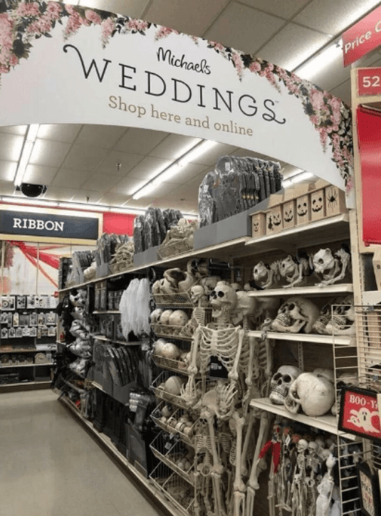 pic of Michaels and an ad for wedding stuff next to an aisle of skeletons