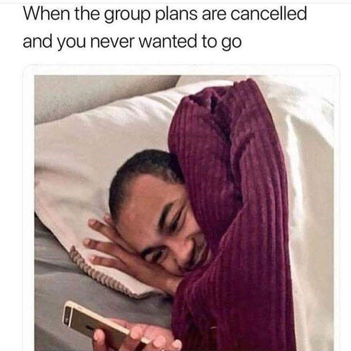 meme about being happy plans are cancelled because you didn't want to go out with picture of man in bed smiling at phone