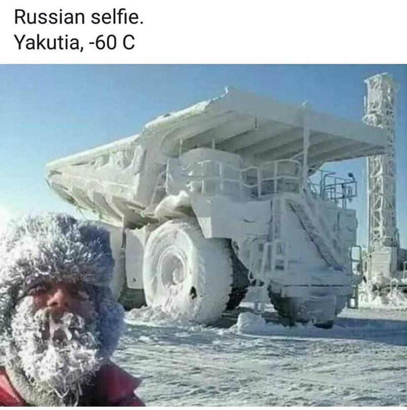 "picture of man with frozen beard next to frozen vehicle captioned ""Russians selfie"""