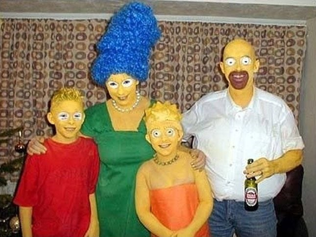 cursed image of family dressed up as realistic Simpsons