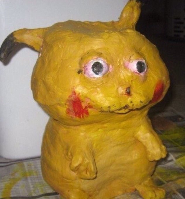 cursed image of deformed Pikachu sculpture