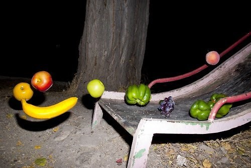 cursed image of floating fruits and vegetables taken as they were sliding down a playground slide