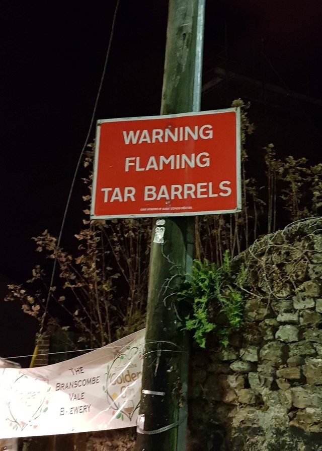 Street sign - WARNING FLAMING TAR BARRELS THE BRANSCOMBE der VALE BEWERY