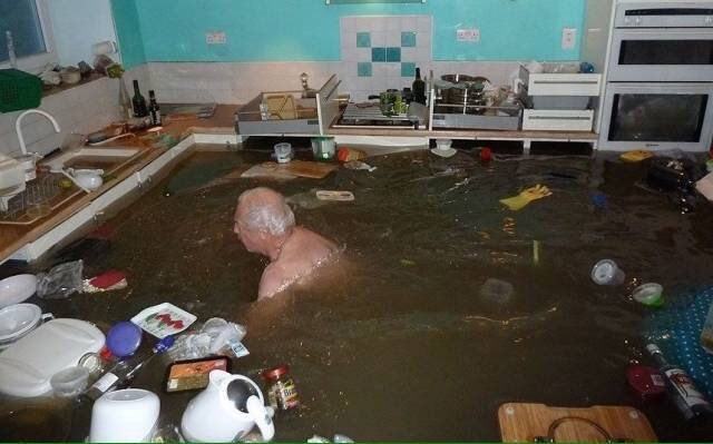 cursed image - pool of water in a kitchen