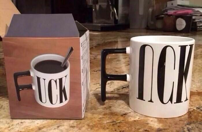 "mug that is supposed to spell ""fuck"" with the handle, but the text is upside down"