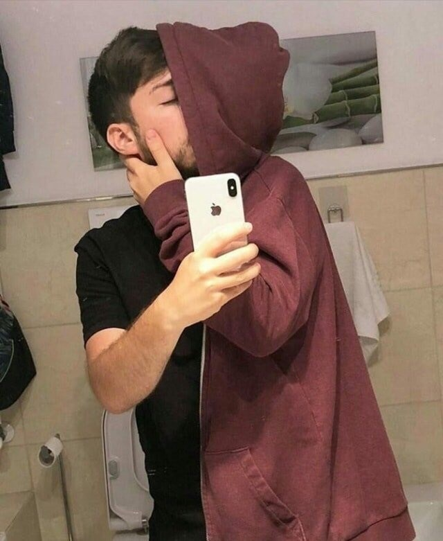 image of a man appearing to be kissing someone but it's really him