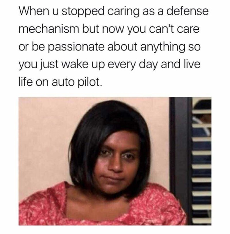 """Caption that reads, """"When you stopped caring as a defense mechanism but now you can't care or be passionate about anything so you just wake up every day and live life on auto pilot"""" above a pic of a sad and tired Mindy Kaling"""