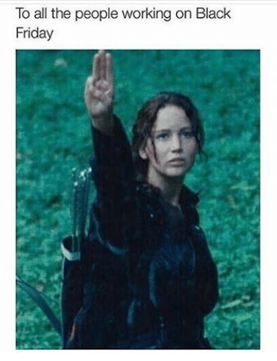 """Caption that reads, """"To all the people working on Black Friday"""" above a pic of Katniss Everdeen saluting three fingers"""