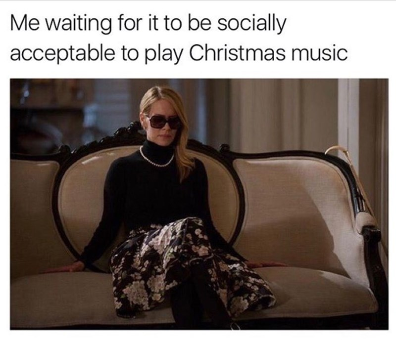 picture of Cordelia from American Horror Story sitting on couch waiting for Christmas season