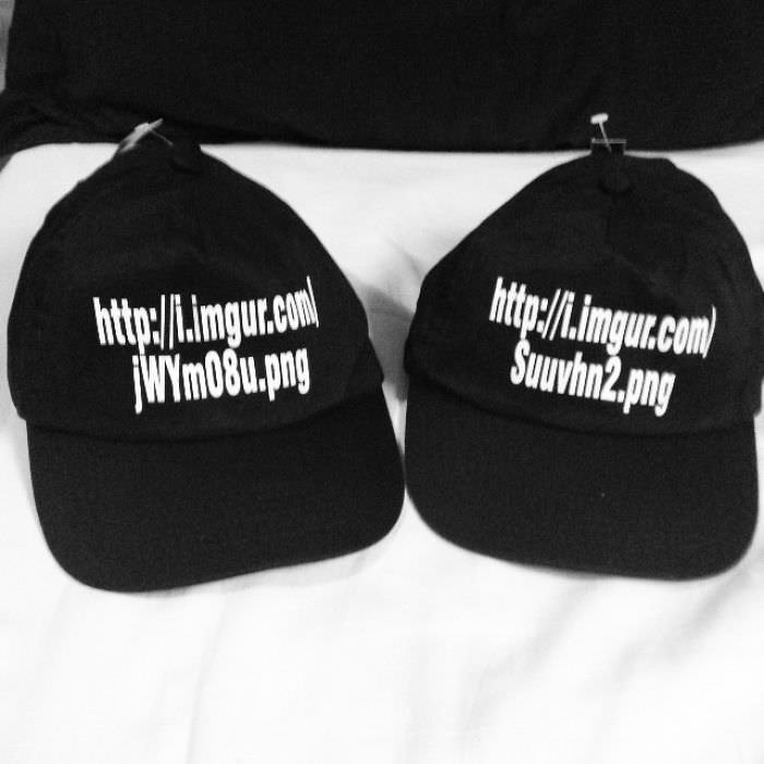 picture of hats printed with the url of the images they were supposed to show