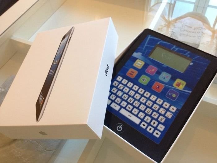 picture iPad package opened to reveal a large calculator inside