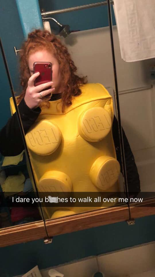 pic of lego costume and daring people to walk over her