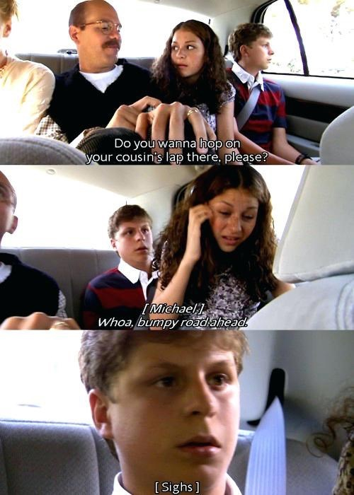 George Michael Bluth looking distressed as Maeby sits on his lap during bumpy car ride