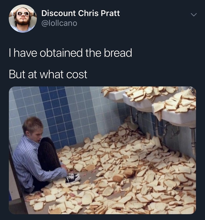 tweet of a man sitting in a corner with slices of bread surrounding him