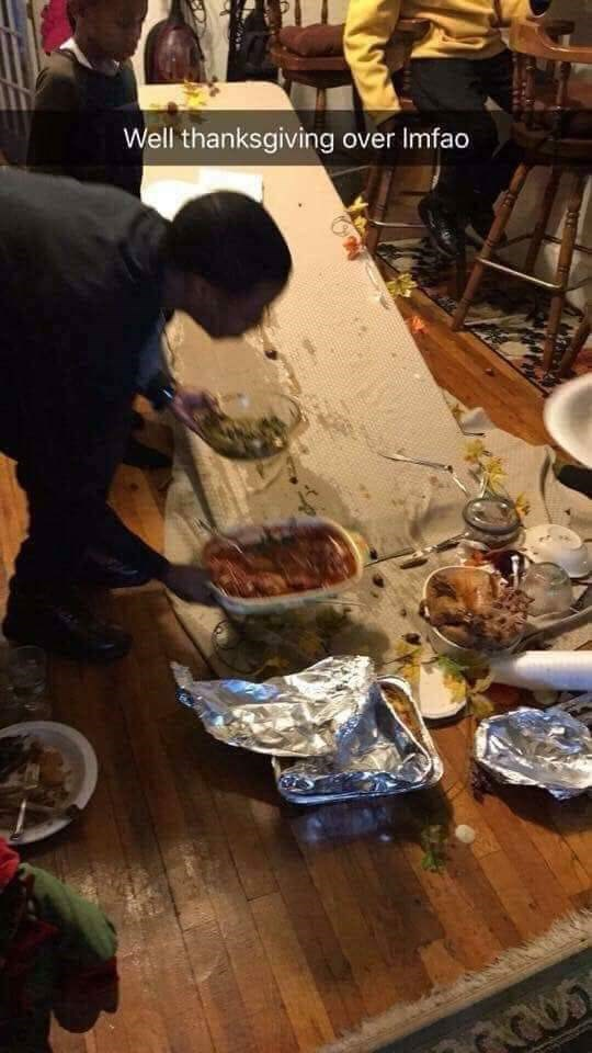 pic of thanksgiving table breaking with all the food on it