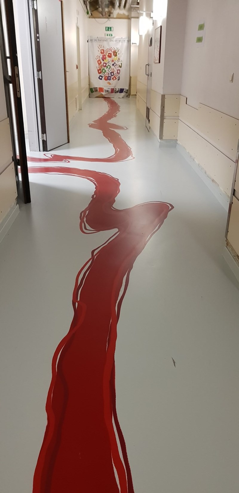 dark design fail of a red paint running down a hall that looks like blood